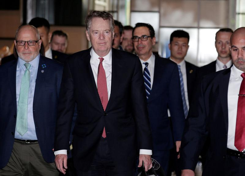 FILE PHOTO: Members of the U.S. trade delegation Robert Lighthizer and Steven Mnuchin arrive at a hotel in Beijing