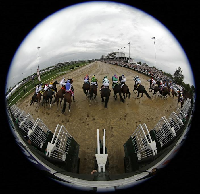 In this image taken with a fisheye lens, horses leave the starting gate during the 139th Kentucky Derby at Churchill Downs Saturday, May 4, 2013, in Louisville, Ky. (AP Photo/Matt Slocum)