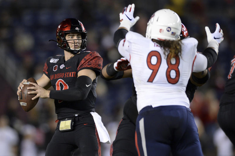 San Diego State quarterback Ryan Agnew (9) looks to pass while pressured by Fresno State defensive tackle Keiti Iakopo (98) during the first half of the NCAA college football game Friday, Nov. 15, 2019, in San Diego. (AP Photo/Orlando Ramirez)