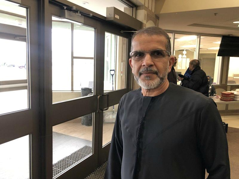 Fareed Amin, president of the Islamic Institute of Toronto, stands near the entrance to the mosque before Friday prayers.