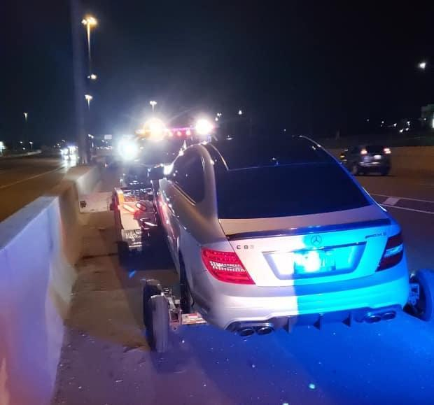 An 18-year-old was charged with stunt driving after the OPP say he was clocked driving 308 km/h on the QEW in May, 2020.  (OPP_HSD/Twitter - image credit)