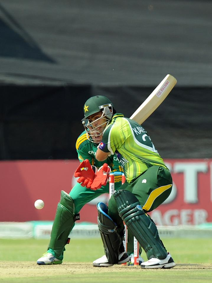 Pakistan's cricketer Kamran Akmal plays a shot  during the fifth and final One-Day Internationals (ODI) cricket match between South Africa and Pakistan in Benoni at Willowmoore Park on March 24, 2013. AFP PHOTO / ALEXANDER JOE        (Photo credit should read ALEXANDER JOE/AFP/Getty Images)