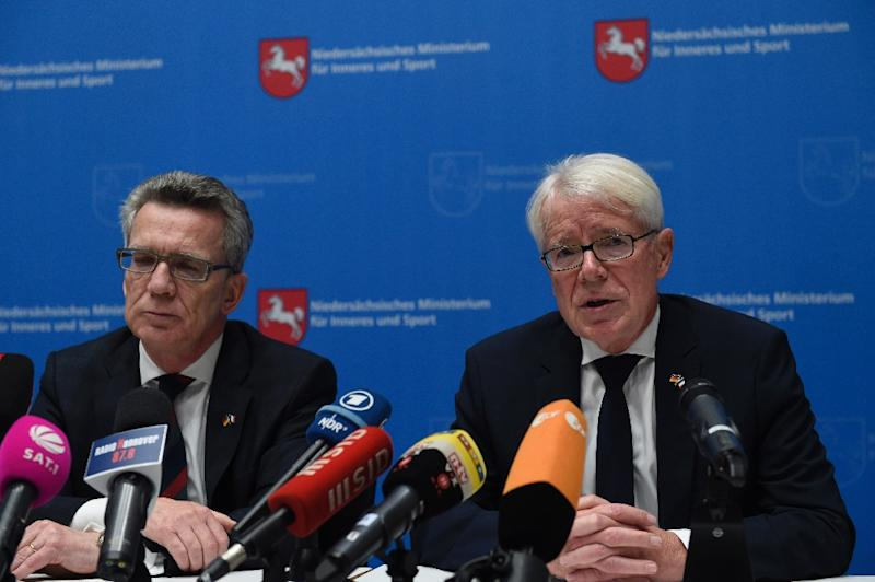 German Interior Minister Thomas de Maiziere (L) and DFB co-interim president Reinhard Rauball speak at a press conference after the friendly football match Germany vs Netherlands was called off for 'security reasons' in Hanover on November 17, 2015 (AFP Photo/Odd Andersen)