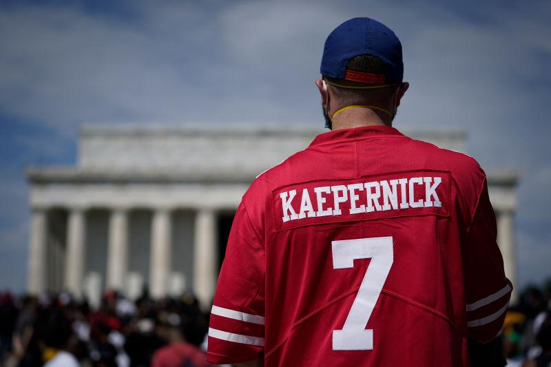 A man wears a Colin Kaepernick jersey during the March on Washington at the Lincoln Memorial August 28, 2020 in Washington, DC.