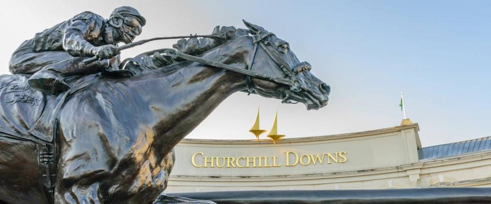 LOUISVILLE, KENTUCKY, USA - MAY 15 2016:   Entrance to Churchill Downs featuring a statue of 2006 Kentucky Derby Champion Barbaro.