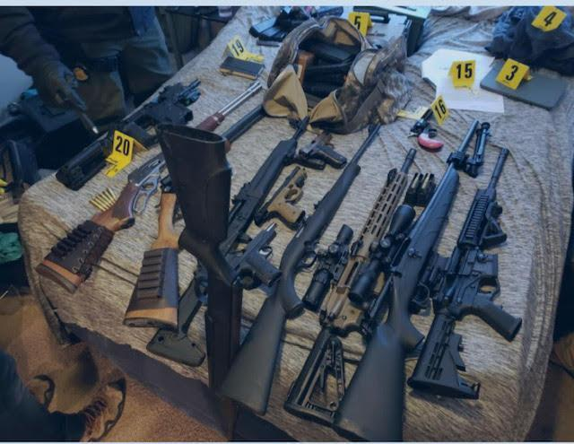 An image of the arsenal found in one suspect's home in recent days. / Credit: FBI