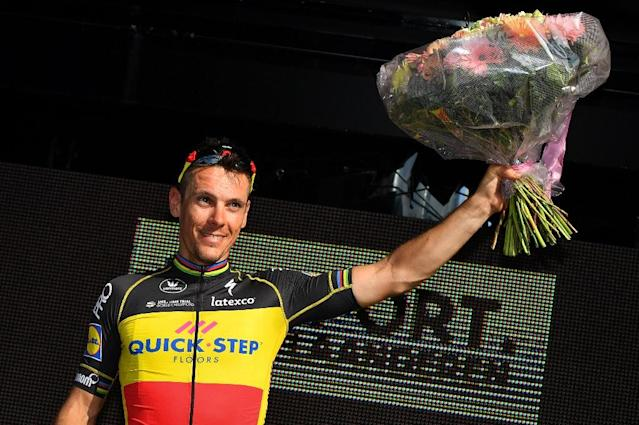 Belgian cyclist Philippe Gilbert of Quick-Step Floors celebrates on the podium after winning the first stage of the Driedaagse De Panne - Koksijde cycling race, 206,2 km from De Panne to Zottegem, on March 28, 2017 (AFP Photo/DAVID STOCKMAN)