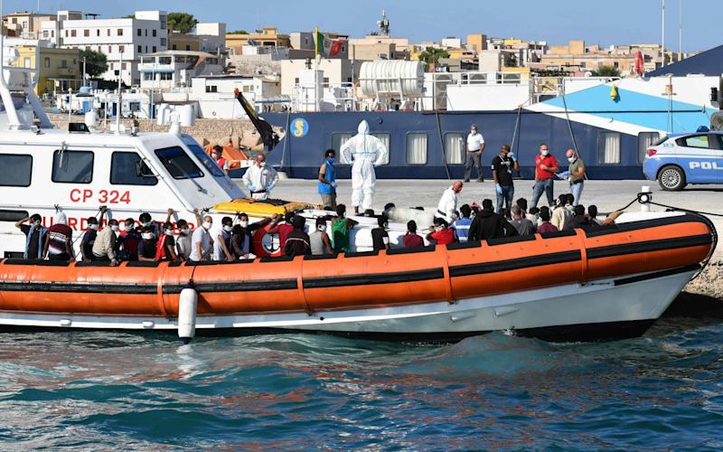 Migrants arrive in Lampedusa after being picked up by the Italian coast guard - AFP