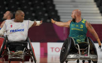 France's Cedric Nankin, left, and Australia's Ryley Batt chat during a Wheelchair Rugby pool match at the Tokyo 2020 Paralympic Games, Thursday, Aug. 26, 2021, in Tokyo, Japan. There are 4,403 Paralympic athletes competing in Tokyo, each with unique differences that have to be classified. Lines have to be draw, in the quest for fairness, to group similar impairments, or impairments that yield similar results. (AP Photo/Shuji Kajiyama)