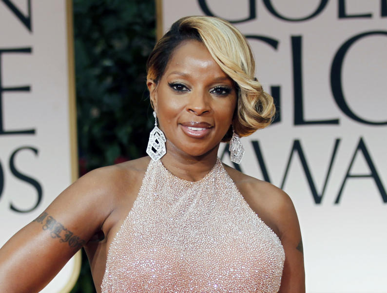 "FILE - In this Jan. 15, 2012 file photo, singer Mary J. Blige arrives at the 69th Annual Golden Globe Awards in Los Angeles. A criticized Burger King commercial featuring Mary J. Blige singing about chicken has been pulled, but the fast-food chain is blaming licensing issues for the decision. In it, Blige sings passionately about the ingredients in the chicken snack wraps. But as the video went viral, some in the black community criticized the ad as stereotypical. The black women-oriented website Madame Noire likened it to ""buffoonery."" Burger King said Tuesday the commercial was pulled because of a music licensing concern and that they hope to have the Blige ""ads back on the air soon."" (AP Photo/Matt Sayles, file)"