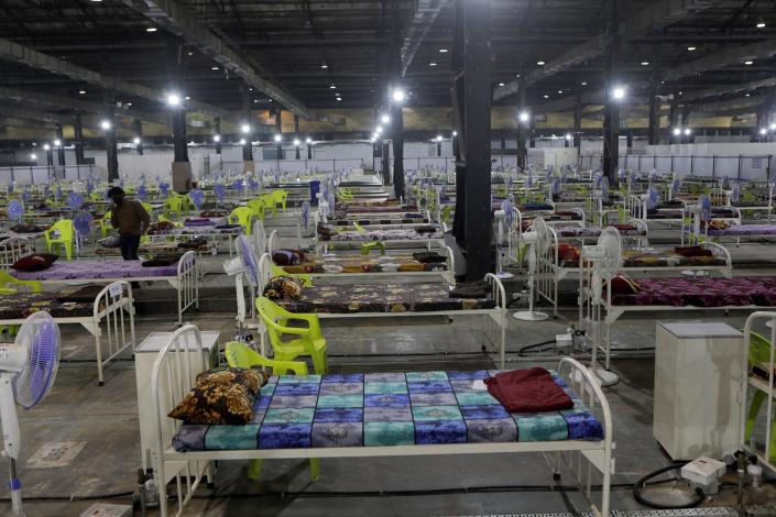 Newly arranged beds lie inside a COVID-19 treatment center set up for emergencies in the wake of spike in the numbers of positive coronavirus cases in Mumbai, India, Thursday, May 6, 2021. Infections in India hit another grim daily record on Thursday as demand for medical oxygen jumped seven-fold and the government denied reports that it was slow in distributing life-saving supplies from abroad. (AP Photo/Rajanish Kakade)