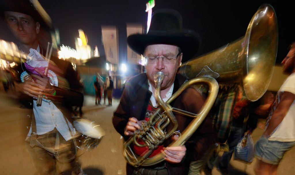 Austrian brass musicians perform a private serenade at the Oktoberfest in Munich, Germany.