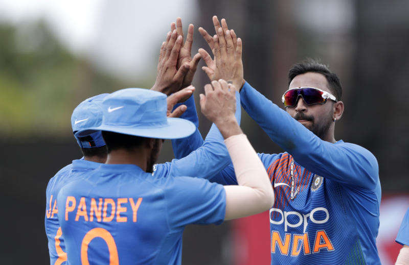 India's Krunal Panda, right, celebrates with India's Manish Pandey, left, after Pandey caught West Indies' Nicholas Pooran during the second Twenty20 international cricket match, Sunday, Aug. 4, 2019, in Lauderhill, Fla. (AP Photo/Lynne Sladky)