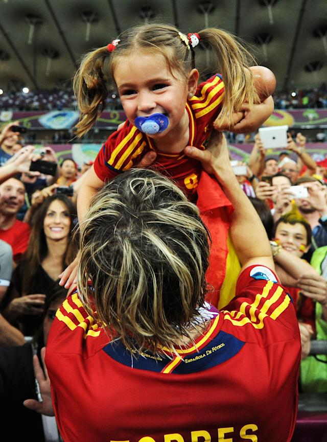 KIEV, UKRAINE - JULY 01: Fernando Torres of Spain holds his daughter Nora Torres following victory in the UEFA EURO 2012 final match between Spain and Italy at the Olympic Stadium on July 1, 2012 in Kiev, Ukraine. (Photo by Jasper Juinen/Getty Images)