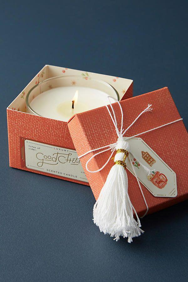 "You can't go wrong with a <a href=""https://www.anthropologie.com/shop/mini-boxed-holiday-candle?category=home-candles&color=060&quantity=1&size=One%20Size&type=REGULAR"" target=""_blank"">holiday-scented candle</a>."