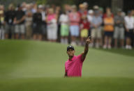<p>Tiger Woods points to his shot on the eighth fairway during a practice round for the Masters golf tournament Tuesday, April 7, 2015, in Augusta, Ga. (AP Photo/Matt Slocum) </p>