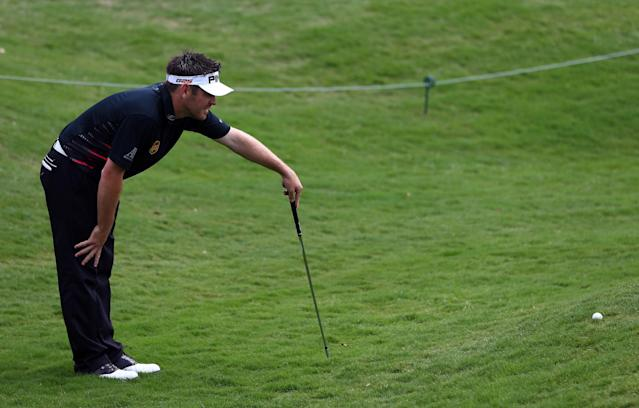 IRVING, TX - MAY 16: Louis Oosthuizen of South Africa eyes a chip shot during the first round of the 2013 HP Byron Nelson Championship at the TPC Four Seasons Resort on May 16, 2013 in Irving, Texas. (Photo by Tom Pennington/Getty Images)