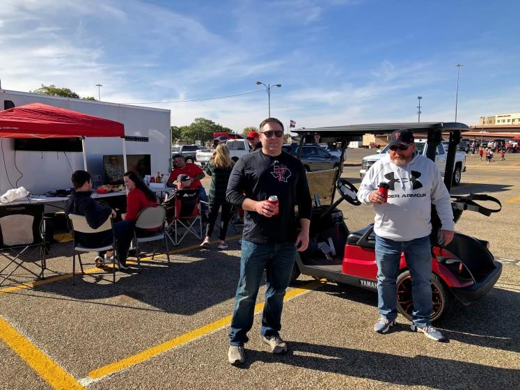 "LUBBOCK, TEXAS - SAT. OCT. 24, 2020 - Car dealers Keith Kiser, 59, of Clovis, N.M., right, and Shane Scarbrough, 39, of Lubbock, left, tailgated Saturday as usual outside the Texas Tech stadium despite a local Covid-19 outbreak. ""At this point in my life, I'm willing to take a few chances,"" Kiser said. (Molly Hennessy-Fiske / Los Angeles Times)"