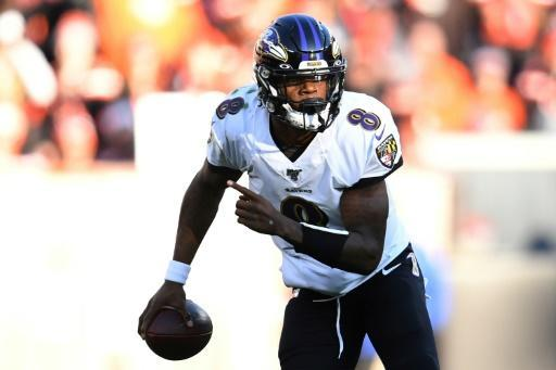 Baltimore's Lamar Jackson, who set an NFL quarterbacks rushing record with 1,206 yards, leads the Ravens against Tennessee in an NFL playoff game Saturday