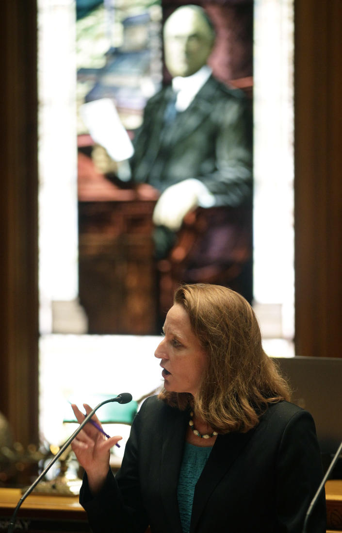 Colorado Senate Democratic Leader Morgan Carroll, whose district includes the Denver suburb Aurora, speaks at the podium during a debate period on a gun control control bill before the Colorado Legislature, at the State Capitol, in Denver, Friday March 8, 2013. Colorado Democrats are on the cusp of advancing gun-control proposals Friday in a state balancing a history of heartbreaking shootings with a Western heritage where gun ownership is treasured by many. (AP Photo/Brennan Linsley)