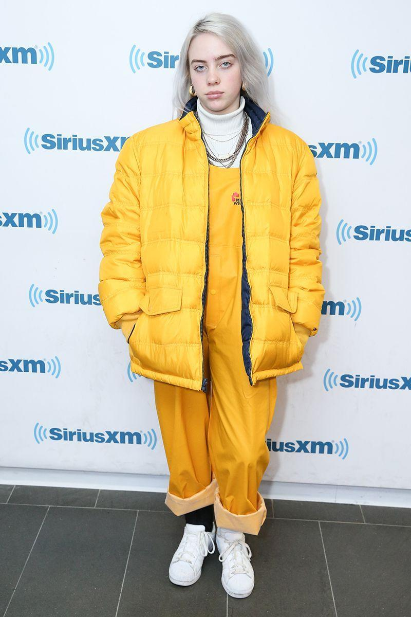 <p>At one of her earlier public appearances, Billie was papped in yellow workmen's dungarees, a matching oversize puffa jacket, and plenty of chains. </p>