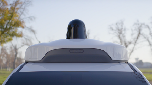The top of a self-driving car equipped with sensors.