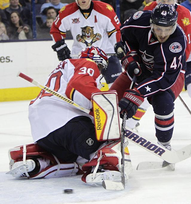 Columbus Blue Jackets' Artem Anisimov, right, of Russia, scores a short-handed goal against Florida Panthers' Scott Clemmensen during the second period of an NHL hockey game Saturday, March 1, 2014, in Columbus, Ohio. (AP Photo/Jay LaPrete)