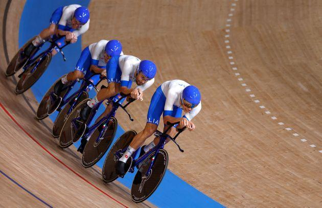 Italy's Simone Consonni, Italy's Filippo Ganna, Italy's Francesco Lamon and Italy's Jonathan Milan compete in the men's track cycling team pursuit qualifying event during the Tokyo 2020 Olympic Games at Izu Velodrome in Izu, Japan, on August 2, 2021. (Photo by Odd ANDERSEN / AFP) (Photo by ODD ANDERSEN/AFP via Getty Images) (Photo: ODD ANDERSEN via AFP via Getty Images)
