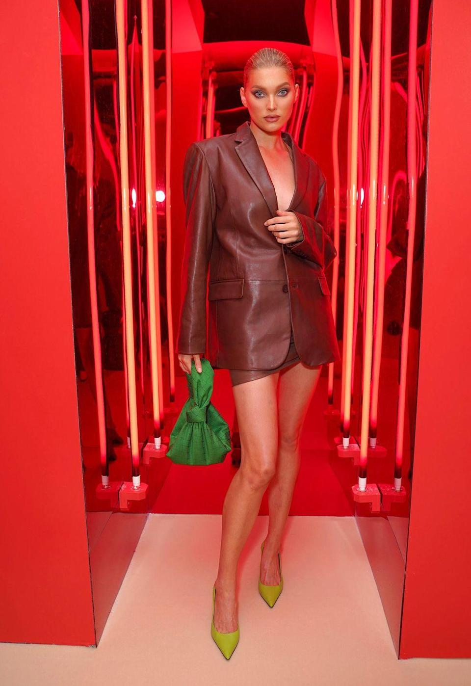 <p><strong>9 September</strong></p><p>The model later changed into a leather two-piece, which she teamed with a green Bottega Veneta bag and heels from The Attico, as she attended the Revolve presentation.</p>