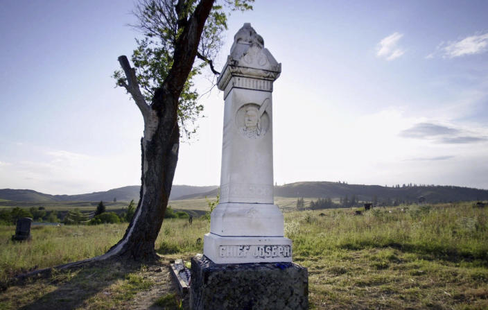 """FILE - In this May 25, 2000, file photo, a monument to Nez Perce leader Chief Joseph, famous for his """"I will fight no more forever"""" speech marking the end of a nearly 1,200-mile running battle with U.S. Army troops, stands at his grave near Nespelem, Wash., on the Colville Indian Reservation. It's been 50 years since the Confederated Tribes of the Colville Reservation voted against termination, effectively ending the federal government's experiment in abrogating treaties, eliminating funding and """"freeing the Indians"""" from the Bureau of Indian Affairs. More than 100 tribes were terminated by the United States — but not one after the 12 bands that make up the reservation in Washington state crushed the idea at the ballot box. (AP Photo/Elaine Thompson, File)"""