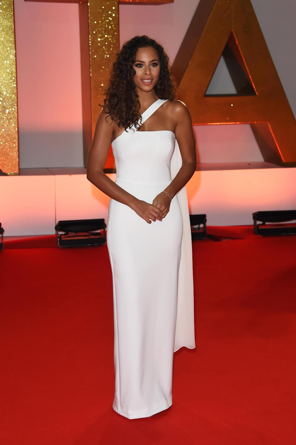 <p>Wearing a minimal white gown by Sassi Holford. <em>[Photo: Getty]</em> </p>