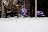 Trump and Biden signs in same Fargo yard