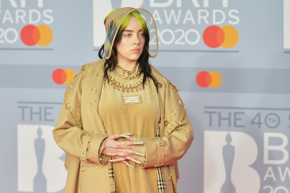 Billie Eilish explains that friends and family were concerned when the 19-year-old was body shamed for wearing a tank top. (Photo: Getty Images)