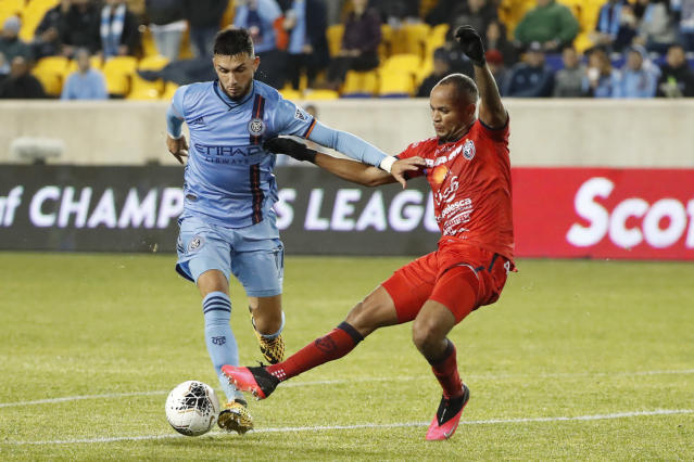 New York City FC midfielder Valentin Castellanos (11) fends off San Carlos defender Pablo Arboine during the first half in the second leg of a CONCACAF Champions League soccer match Wednesday, Feb. 26, 2020, in Harrison, N.J. (AP Photo/Kathy Willens)