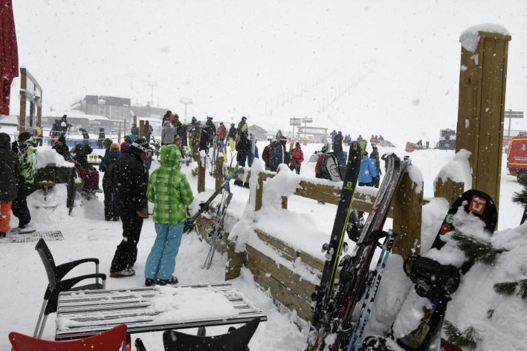 People wait at the Tignes ski resort in the French Alps, on March 7, 2017