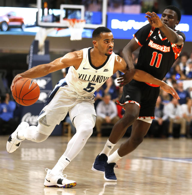 Villanova guard Phil Booth (5) moves past Morgan State guard Malik Miller (11) in the first half of an NCAA college basketball game, Tuesday, Nov. 6, 2018, in Villanova, Pa. (AP Photo/Laurence Kesterson)