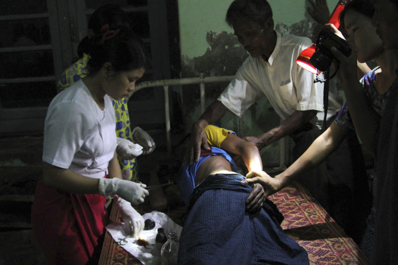In this Oct. 25, 2012 photo, Rakhine refugees receive medical treatment at Kyauktaw hospital in Kyauktaw, Rakhine State, western Myanmar. At least 56 people have been killed and 1,900 homes destroyed in renewed ethnic violence between the Buddhist Rakhine and Muslim Rohingya communities in western Myanmar as the government warned perpetrators and the international community appealed for calm. (AP Photo/Khin Maung Win)