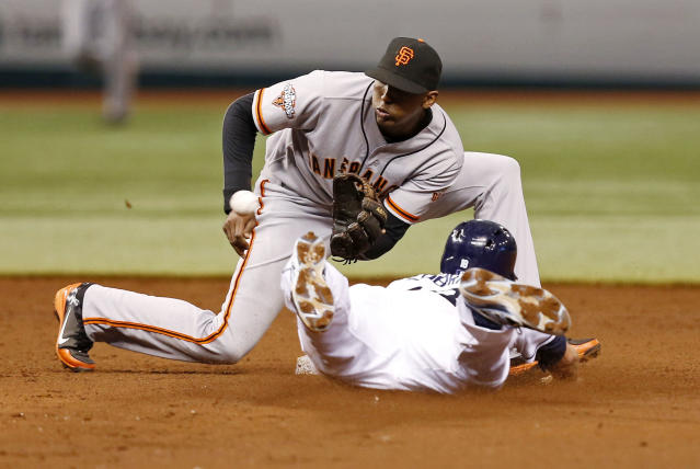 San Francisco Giants second baseman Joaquin Arias awaits a throw on a steal attempt by Tampa Bay Rays' Ben Zobrist that was nullified when batter Evan Longoria struck out on the play to end the third inning of a baseball game Saturday, Aug. 3, 2013, in St. Petersburg, Fla. (AP Photo/Mike Carlson)