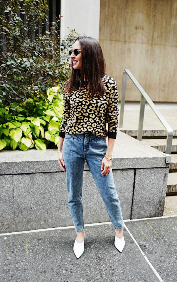 <p>For a day at the office, a tailored pair of jeans are perfectly polished with this leopard-print sweater. </p>