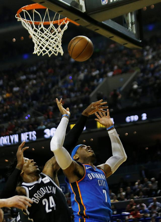 Basketball - NBA Global Games - Brooklyn Nets v Oklahoma City Thunder - Arena Mexico, Mexico City, Mexico December 7, 2017. Carmelo Anthony of Brooklyn Nets and Rondae Hollis of Oklahoma City Thunder in action. REUTERS/Carlos Jasso