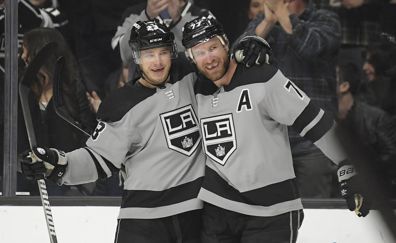 Los Angeles Kings center Jeff Carter, right, celebrates his goal with right wing Dustin Brown during the second period of the team's NHL hockey game against the Anaheim Ducks on Saturday, March 23, 2019, in Los Angeles. (AP Photo/Mark J. Terrill)