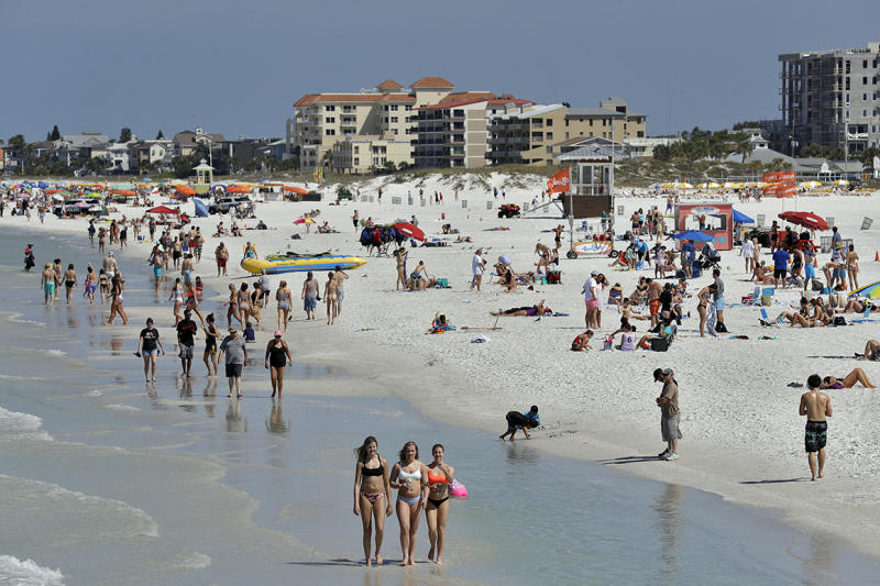 Colleges cancel partying holiday to tamp down virus spread