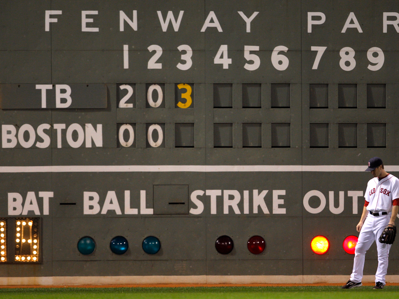 Boston Red Sox left fielder Jason Bay stands in front of the scoreboard in the third inning against the Tampa Bay Rays in Game 5 of Major League Baseball's ALCS playoff series in Boston.