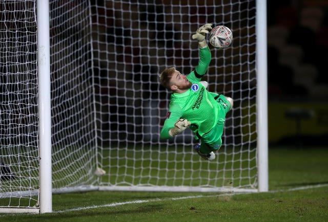 Jason Steele atoned for an earlier error by  making four saves in the shoot-out as Brighton avoided a cup upset at League Two Newport