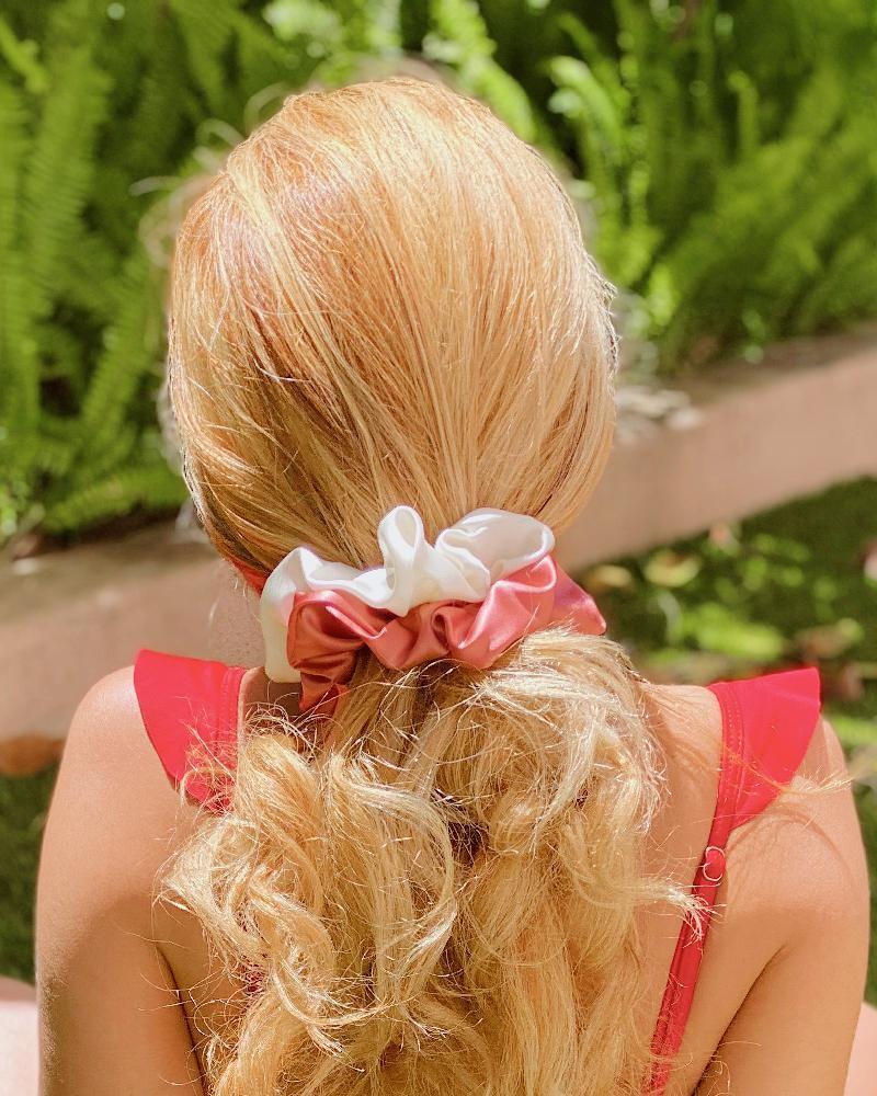 """I love Sonix's Silk Two-Tone Scrunchie Set—it's made of 100% mulberry silk and perfect for putting your hair up in the <a href=""""https://www.glamour.com/gallery/easy-summer-hairstyles-for-every-length-and-texture?mbid=synd_yahoo_rss"""" rel=""""nofollow noopener"""" target=""""_blank"""" data-ylk=""""slk:hot summer months"""" class=""""link rapid-noclick-resp"""">hot summer months</a>. —<em>J.R.</em> $22, Sonix. <a href=""""https://shopsonix.com/collections/best-sellers/products/silk-two-tone-scrunchie-set-pink-cream"""" rel=""""nofollow noopener"""" target=""""_blank"""" data-ylk=""""slk:Get it now!"""" class=""""link rapid-noclick-resp"""">Get it now!</a>"""