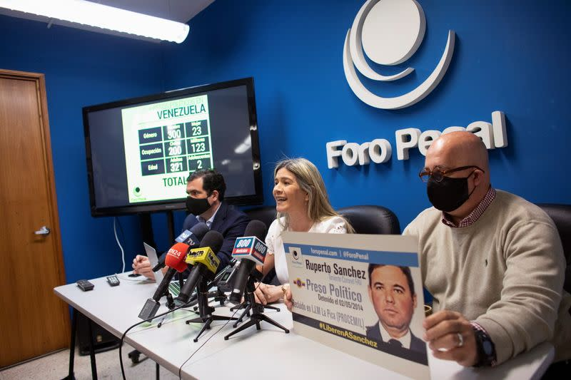 Kerling Rodriguez de Sanchez, wife of Venezuelan Air Force Lieutenant Colonel Ruperto Sanchez, who has been detained since 2014, addresses the media during a news conference by rights group Penal Forum, in Caracas