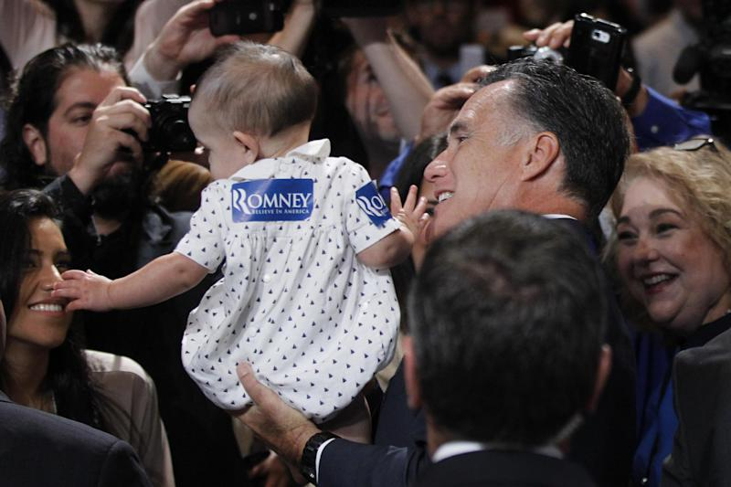 Republican presidential candidate, former Massachusetts Gov. Mitt Romney, holds a baby as he greets attendees at the NALEO (National Association of Latino Elected and Appointed Officials) conference in Orlando, Fla., Thursday, June 21, 2012. (AP Photo/Charles Dharapak)