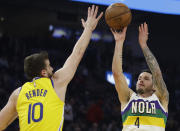 New Orleans Pelicans' JJ Redick, right, shoots against Golden State Warriors' Dragon Bender (10) during the first half of an NBA basketball game Sunday, Feb. 23, 2020, in San Francisco. (AP Photo/Ben Margot)