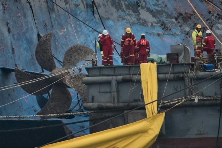About 450 workers are involved in the elaborate operation to lift the Sewol
