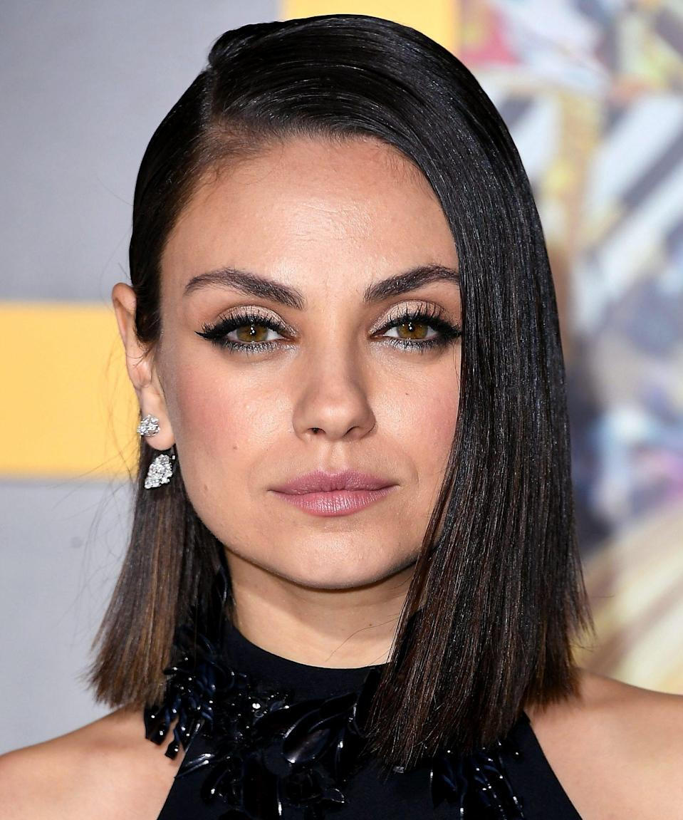 A deep side part and super sleek strands bring tons of drama.
